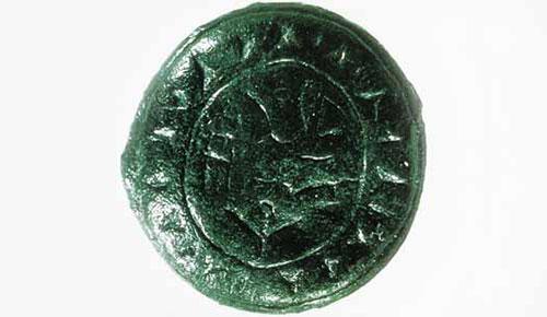1995'te Troya'da bulunan ve neredeyse evrensel olan Anadolu Luvi dilinde yazılmış bronz bir mühür