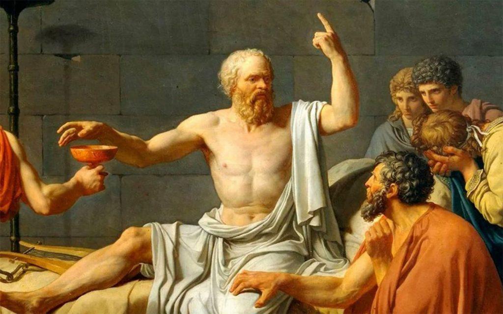 Sokrates zehirli baldıran tasını yutmaya hazırlanırken dimdik oturur